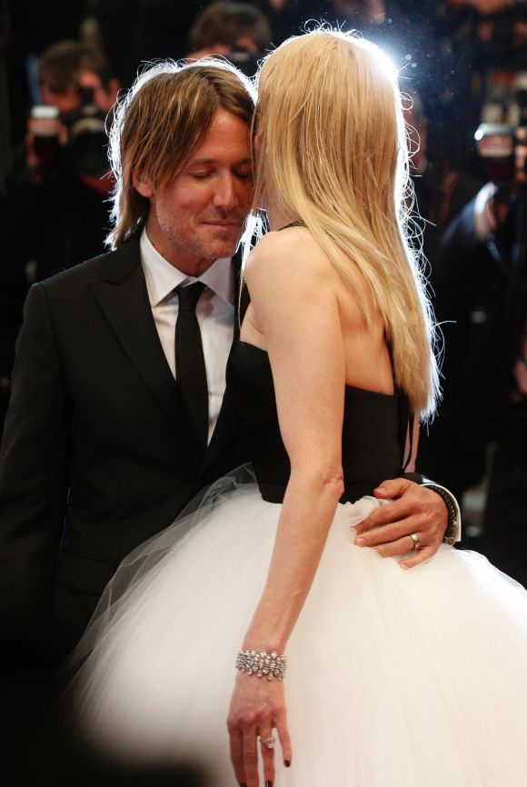 Belle of the ball Nicole Kidman and her husband Keith Urban pack on the PDA after the screening of the film The Killing ...