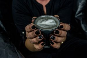 Nat Lange from Espresso Yourself coffee van and her new trend Goth lattes- coffee made with activated charcoal. Photo by ...
