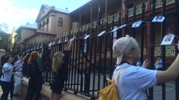 Abortion campaigners hang coat hangers up outside Parliament House as part of their protest.