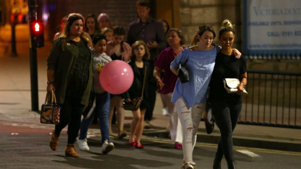 Members of the public are escorted from the Manchester Arena after the suicide bombing attack.