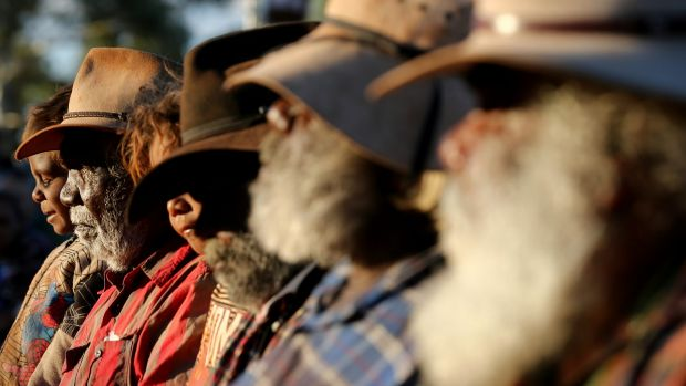 Mutitjulu elders watch performers from Muakgau Lak Gubau Gizu during the opening ceremony of the convention.