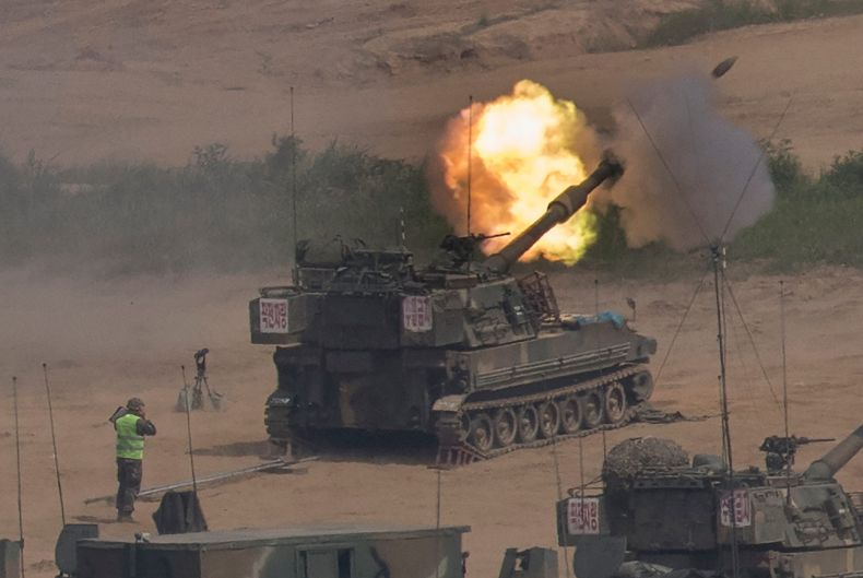 South Korean army's K-55 self-propelled howitzer fires during the annual exercise in Paju, near the border with North Korea.
