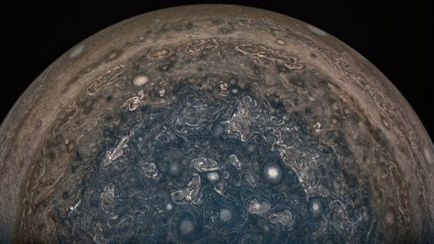 Monstrous cyclones churning over Jupiter's poles discovered by Juno spacecraft