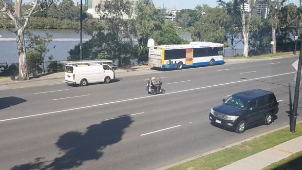 The man on his scooter slowed traffic along the busy road.
