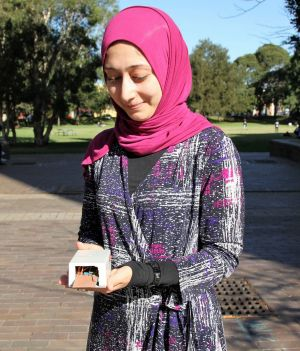 Sara Khalifa with the first gait-authentication prototype in hand.