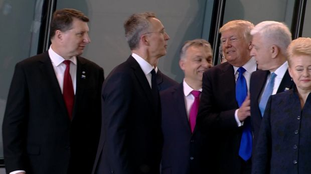 Getting ahead: US President Donald Trump pushes Montenegro Prime Minister Dusko Markovic, second right, at the NATO ...
