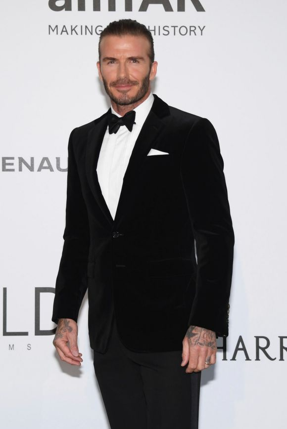Former soccer player David Beckham opted for classic black-tie attire for the amFAR charity gala.