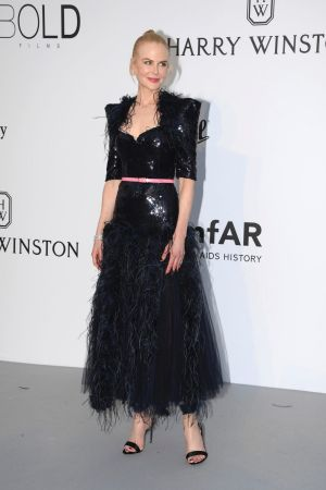 Actress Nicole Kidman poses for photographers upon arrival at the amfAR charity gala.