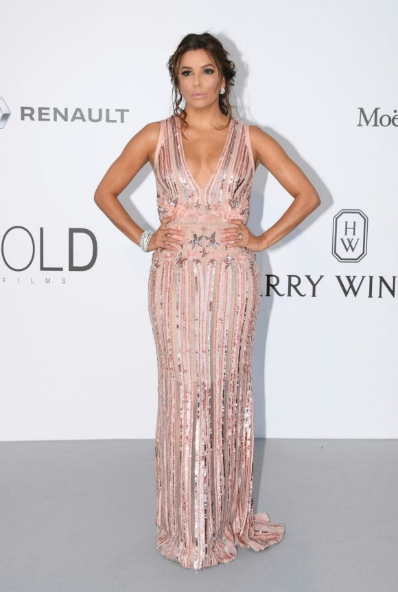 Actress Eva Longoria opted for a heavily embellished blush pink gown at the amfAR charity gala.