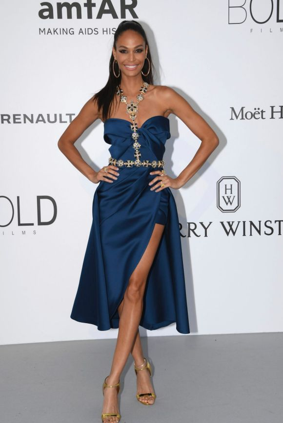 While most of the celebrities opted for blacks and blushing pastels, model Joan Smalls made a statement in her ...