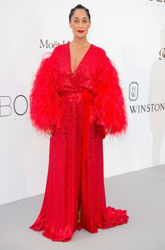 Tracee Ellis Ross brought the missing red to the white amFAR carpet, with a diva crimson robe designed by Jenny Packham.