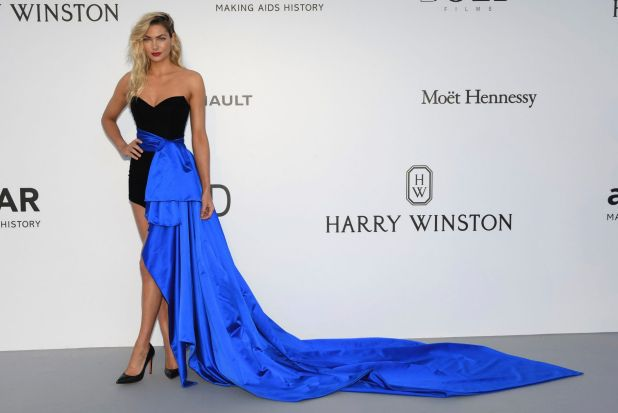 In a similar fashion to Kendall Jenner's look earlier in the week model Jessica Hart poses for photographers in a black ...