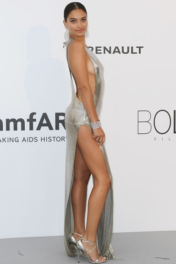 Shanina Shaik dared to bear in a silver side-plunging gown as she arrived at the amfAR Gala.