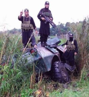 Militants bearing Islamic State insignia stand on an armoured vehicle in the Marawi area. Foreign fighters are among the ...