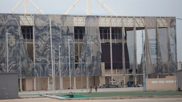 The translucent tapestries created by Brazilian artist Adriana Varejao fall from the exterior of the aquatic stadium in ...
