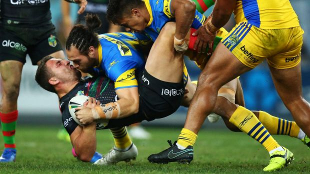 Slammin' Sam: The Eels put Bunnies captain Sam Burgess on his back.