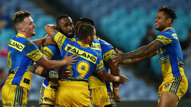 In form: Semi Radradra is congratulated after scoring last week against Souths.