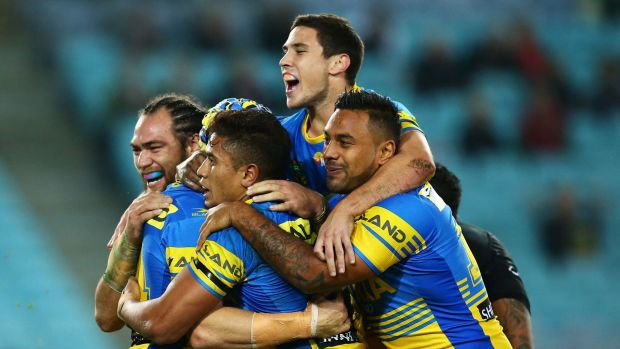Eel high: Mitchel Moses and Parramatta teammates celebrate.