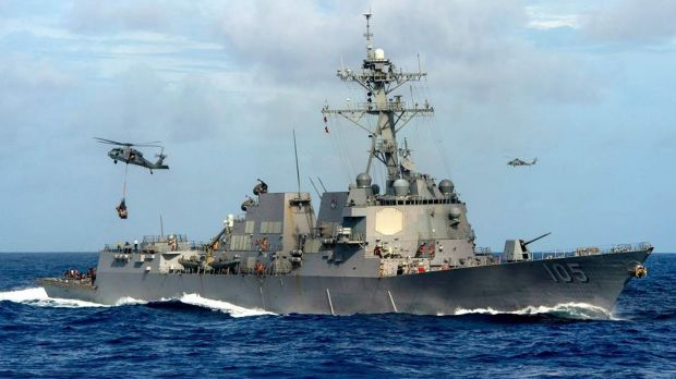 """The USS Dewey conducted a """"man overboard"""" exercise near Mischief Reef on Thursday."""