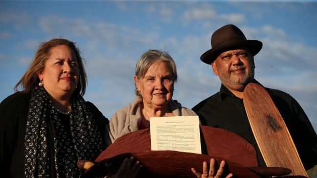 Megan Davis, Pat Anderson from the Referendum Council holding the Uluru Statement from the Heart, and Noel Pearson.