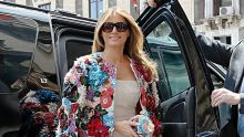 Misreading the mood ... Melania Trump, in a $70,000 Dolce & Gabbana jacket, attending an economic summit in Italy.