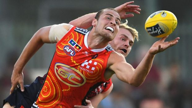 Gold Coast's Jarrod Witts competes with Melbourne's Jack Watts.