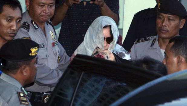 Schapelle Corby covered her head with a scarf ias she left the parole office in Bali on Saturday.