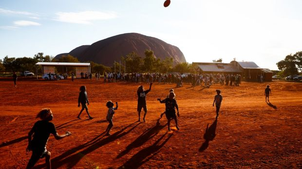 Children playing footy during the closing ceremony in the Mutitjulu community of the First Nations National Convention ...