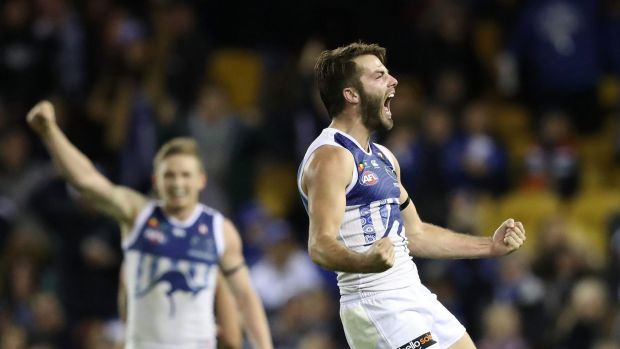 Luke McDonald of the Kangaroos celebrates after kicking a goal at Etihad Stadium on Sunday.