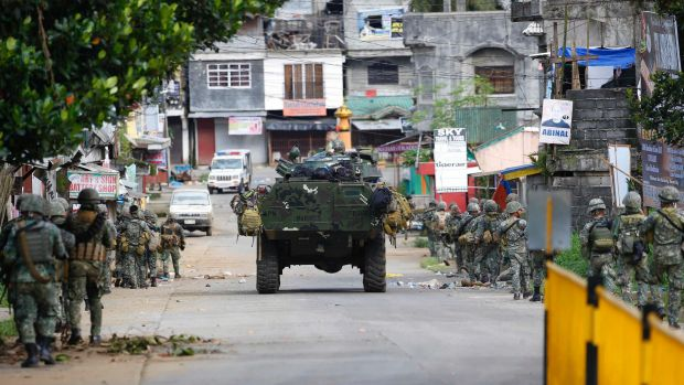 Philippine marines walk to the frontline in the continuing assaults to retake control of some areas of Marawi.