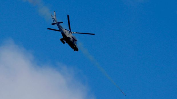 A helicopter gunship fires a rocket at Muslim militant positions in the continuing assaults to retake control of some ...
