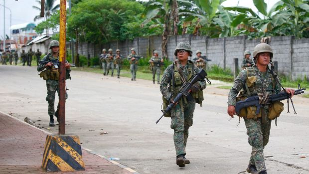 Philippines urges Islamist militants to surrender