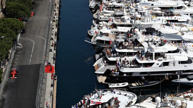 The best seats in the house: The rich and famous watch Kimi Raikkonen from the water in Monte Carlo.