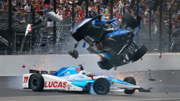 IndyCar driver Scott Dixon gets airborne after colliding with Jay Howard in the Indianapolis 500.