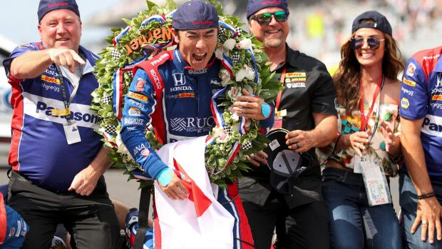 Japanese driver Takuma Sato celebrates his victory in the 101st Indy 500.