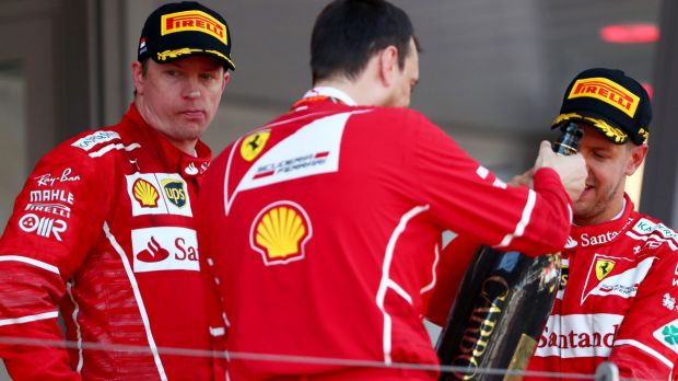 Not happy: Ferrari driver Kimi Raikkonnen (left) made clear in post-race interviews that he was not pleased with team ...