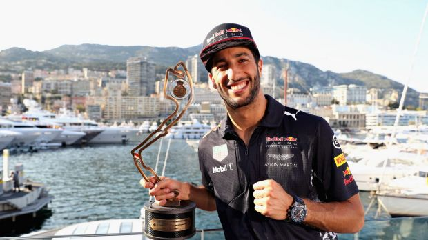 """A """"much happier"""" Ricciardo with this third-place trophy."""