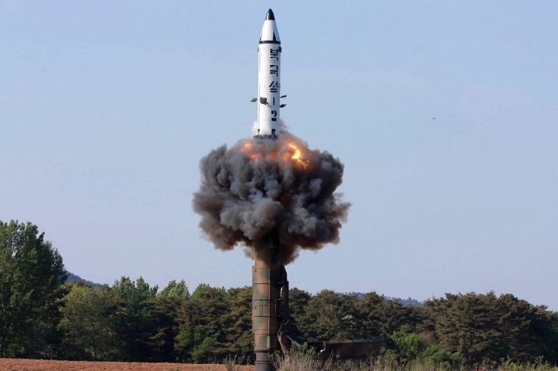 """A solid-fuel """"Pukguksong-2"""" missile lifts off during its launch test at an undisclosed location in North Korea in May. A ..."""
