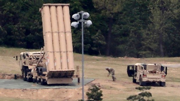 A US missile defence system called Terminal High Altitude Area Defense, or THAAD, is installed at a golf course in ...