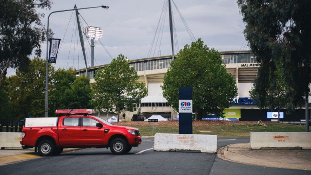 Concrete bollards and a car parked to block road access outside Canberra Stadium to increase security.