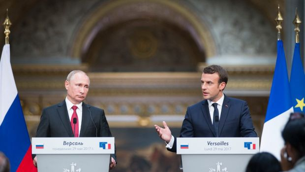 Vladimir Putin and Emmanuel Macron hold a press conference at the Palace of Versailles after their talks.