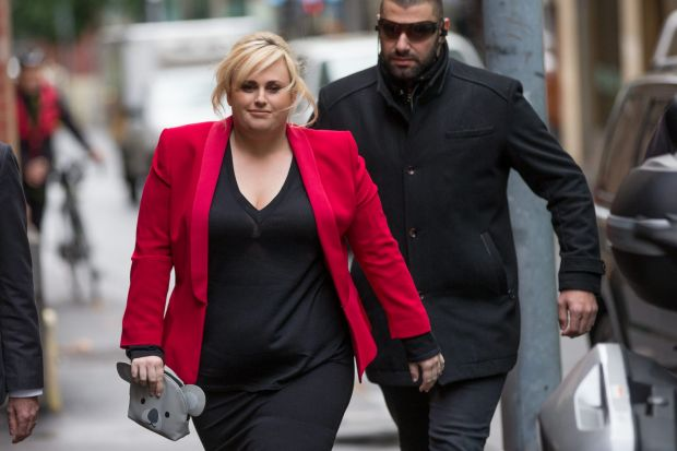 Hollywood actress Rebel Wilson arrives at Melbourne's Supreme Court with lawyers and security in her defamation case ...