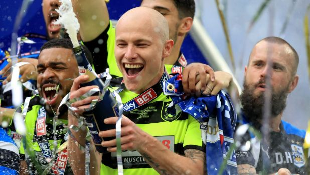 Huddersfield Town's Aaron Mooy celebrates winning the Sky Bet Championship play-off final at Wembley Stadium, London. ...