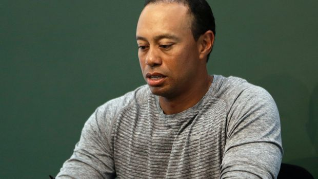 Under the spotlight: Tiger Woods, pictured at a book signing in May.