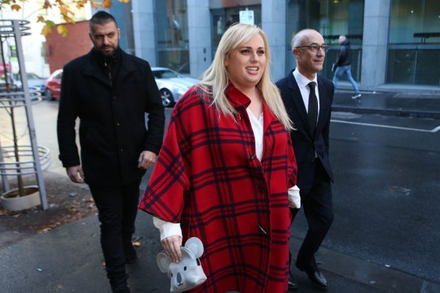 Rebel wears tartan: Rebel Wilson appears outside court.