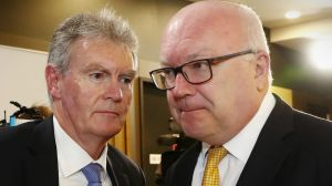 ASIO Director-General of Security Duncan Lewis and Attorney-General Senator George Brandis in May.