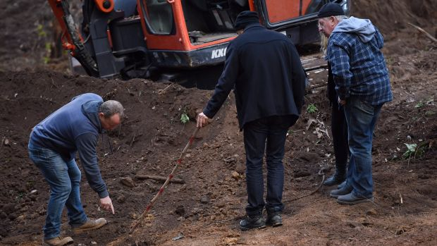 Detectives show Mark and Faye Leveson where they found bones.