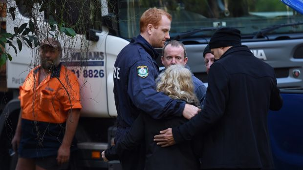 Detectives embrace Matthew Leveson's parents Mark (second right) and Faye (third left) after locating the possible ...