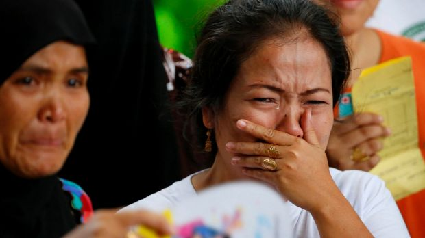 Displaced residents of Marawi city cry upon receiving assurance of support from local officials at an evacuation centre ...