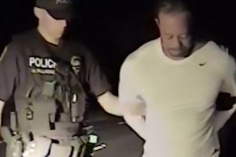 Sorry sight: Tiger Woods is placed under arrest.